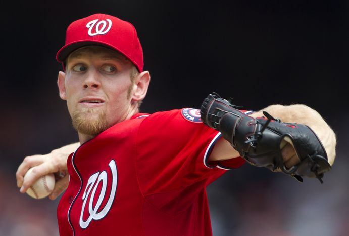 Washington Nationals starting pitcher Stephen Strasburg throws during the first inning of a baseball game against the Baltimore Orioles in Washington, Sunday