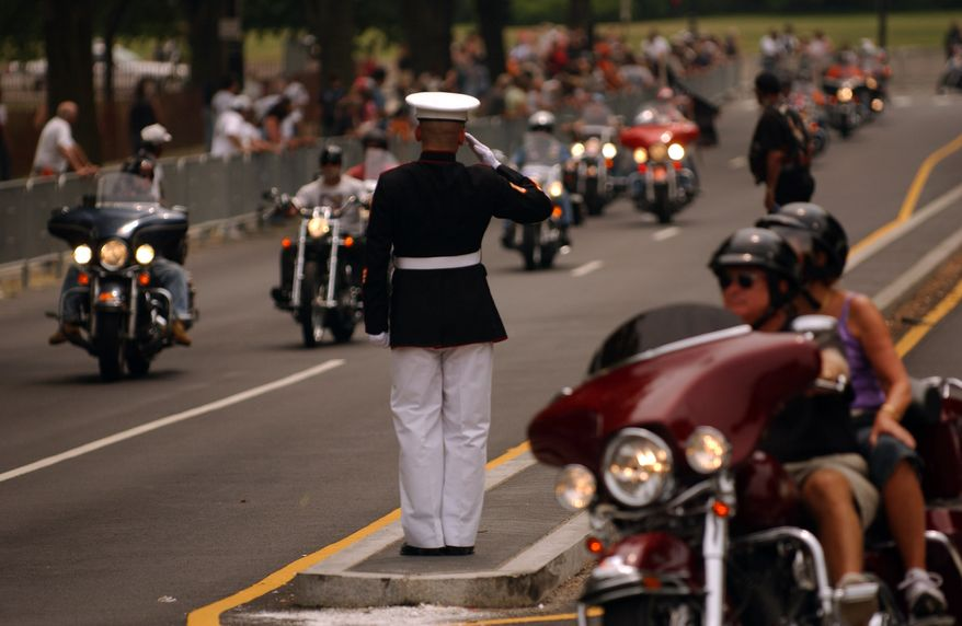 Tens of thousands of motor cyclists are saluted while joining the 20th anniversary of 'Rolling Thunder' near the Lincoln Memorial NW Washington, D.C., Sunday, May 27, 2007. The cyclists, of whom many served in the U.S. Military, gathered first on the parking lots around the Pentagon in Virginia as early as 7am this morning before crossing over to the District on Memorial Bridge and heading towards the U.S. Capitol on Constitution Avenue before returning back to the Lincoln Memorial on Independence Avenue. The event draws a huge crowd of visitors to the National Mall and many could hear the 'Rolling Thunder' for several hours. (Astrid Riecken/The Washington Times )