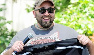 "FILE - In this May 1, 2011 file photo, Duff Goldman, the cake master behind Food Network's reality show ""Ace of Cakes, speaks at The Los Angeles Times Festival of Books at the University of Southern California in Los Angeles. YouTube's latest original content channel, HUNGRY, which goes live on July 2, is expected to feature a freewheeling blend of how-to and celebrity-driven food videos. One of the series will feature Goldman's ""Duff's Food World,"" a sometimes irreverent variety show focused on food pop culture, including visits to unusual restaurants and spotlights of humorous food clips from the web and TV. (AP Photo/Katy Winn)"
