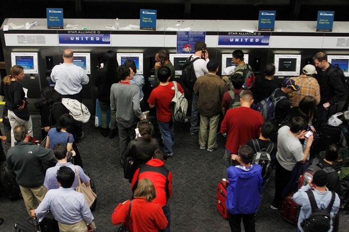 With airlines setting aside more window and aisle seats for passengers willing to pay extra, an increasing number of friends and family members are finding it difficult to secure seats next to each other. (Associated Press)
