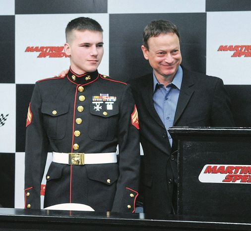 Wounded war veteran Marine Cpl. J.B. Kerns, 22, joins actor and military activist Gary Sinise at a February news conference in Martinsville, Va. After canceling a March benefit concert for Cpl. Kerns, Mr. Sinise is set to perform with his Lt. Dan Band in Martinsville on Thursday. (Associated Press)