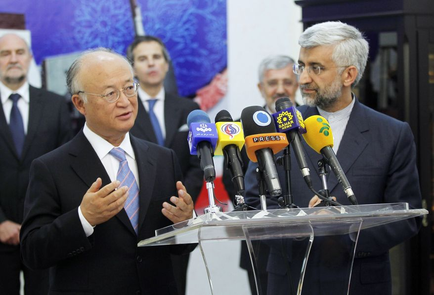 Yukiya Amano (left), chief of the International Atomic Energy Agency, met with Iran's top nuclear negotiator, Saeed Jalili (right), on Monday in Tehran, hoping to get the OK to resume inspections of the Islamic republic's nuclear sites. (Associated Press)