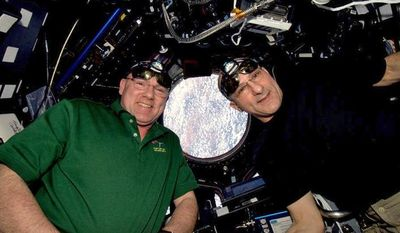 Dutch astronaut Andre Kuipers (left) and American astronaut Donald Pettit, pictured on Friday, April 20, 2012, will use the International Space Station's robot arm to snare and berth the SpaceX Dragon supply capsule. (AP Photo/NASA and the European Space Agency)