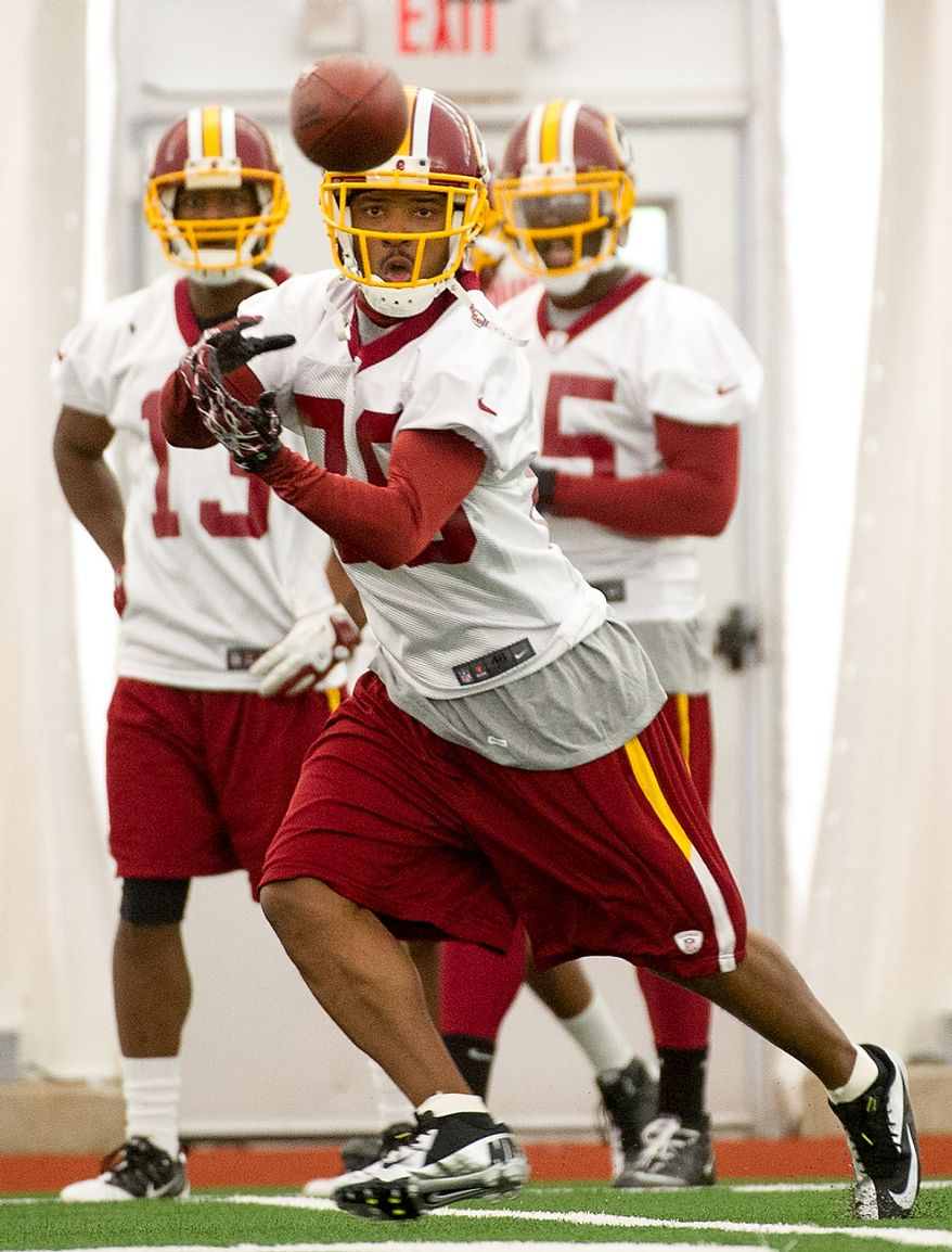Washington Redskins wide receiver Santana Moss (89) catches a pass as the Washington Redskins begin their first day of organized team activity at Redskins Park, Ashburn, Va., Monday, May 21, 2012. (Andrew Harnik/The Washington Times)
