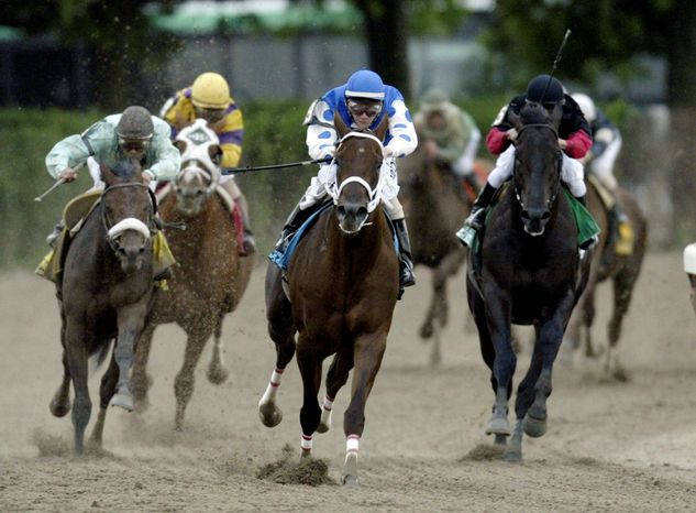 Smarty Jones (center, with jockey Stewart Elliott aboard) won the first two legs of the Triple Crown in 2004,
