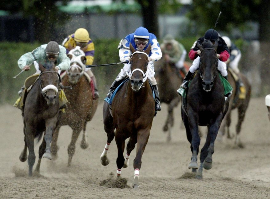 Smarty Jones (center, with jockey Stewart Elliott aboard) won the first two legs of the Triple Crown in 2004, only to finish second to Birdstone in the Belmont Stakes. (Associated Press)