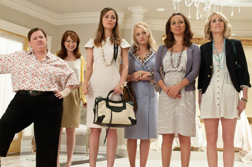 """Kristen Wiig (far right) earned an Oscar nomination for the screenplay for """"Bridesmaids"""" (in which she starred with, from left, Melissa McCarthy, Ellie Kemper, Rose Byrne, Wendi McLendon-Covey and Maya Rudolph). For her Saturday night farewell on """"Saturday Night Live,"""" she received an emotional, high-profile send-off after seven years as part of the cast on the NBC-TV show. (Universal Pictures via Associated Press)"""