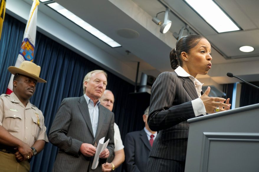 State's Attorney Angela Alsobrooks announced Tuesday that the owners and operators of seven nightclubs in Prince George's County were indicted for failure to pay taxes on cover charges, food and drinks served at their establishments. State Comptroller Peter V.R. Franchot (center) looks on during the press conference. (Barbara L. Salisbury/The Washington Times)