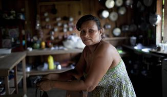 Hilaria Zavala, interviewed on Monday, May 21, 2012, says six men kicked in her door about 3 a.m. on Friday, May 11, threw her husband on the ground, put a gun to his head and then took him away for two hours during a commando drug raid in Ahuas, Honduras. (AP Photo/Rodrigo Abd)
