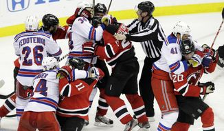 The New York Rangers have alternated wins and losses in their last 11 playoff games. The Eastern Conference final series with the New Jersey Devils is tied at two games apiece. (AP Photo/Kathy Willens)