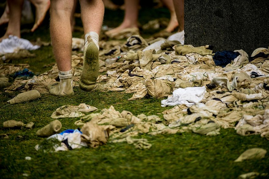"Lard covered shirts are strewn about as first year Naval Academy plebes finish the traditional Herndon Monument climb in two hours and ten minutes, Annapolis, Md., Tuesday, May 22, 2012. The tradition, dating back to 1940, is the culmination of the first year in the Naval Academy where the plebe class has to help each other climb the obelisk covered in lard, remove the ""dixie cup"" hat at the top and replace it with an upperclassman's hat. (Andrew Harnik/The Washington Times)"