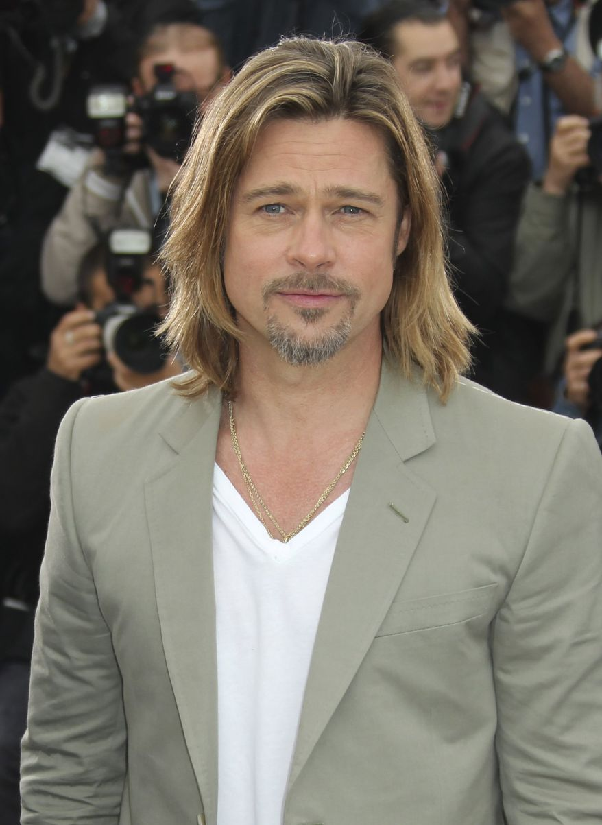 "Actor Brad Pitt poses during a photo call for ""Killing Them Softly"" at the 65th international film festival, in Cannes, southern France, Tuesday, May 22, 2012. (AP Photo/Joel Ryan)"
