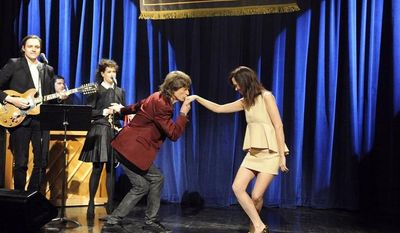 "Mick Jagger was the host when ""Saturday Night Live"" bid farewell to Kristen Wiig, who got a kiss after her dance with the Rolling Stones' icon and then spun through numbers with members of the SNL cast and the show's creator, Lorne Michaels. (NBC via Associated Press)"
