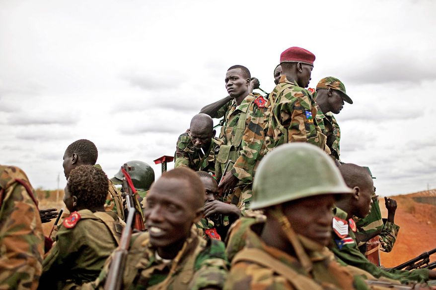 Soldiers in the South Sudan army move toward frontline positions in Unity State. Tensions between Sudan and South Sudan erupted in late April into armed conflict along their poorly defined border. (Associated Press)