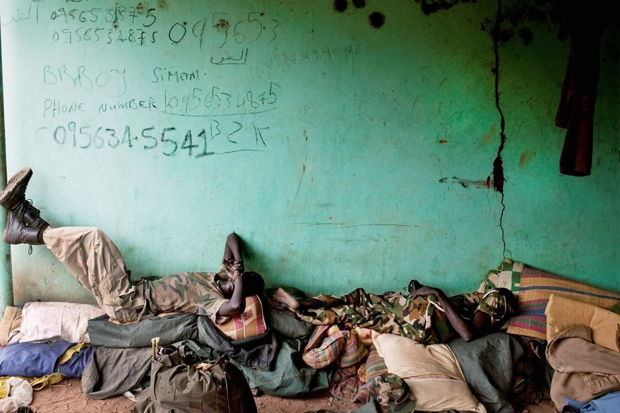 Other soldiers rest inside the Sudan People's Liberation Army headquarters in Bentiu. (Associated Press)