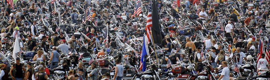 Tens of thousands of motorcyclists wait in Pentagon parking lots to join the 20th Rolling Thunder parade in May 2007. Rolling Thunder's prime focus has been and continues to be those missing in action and known prisoners of war. (The Washington Times)