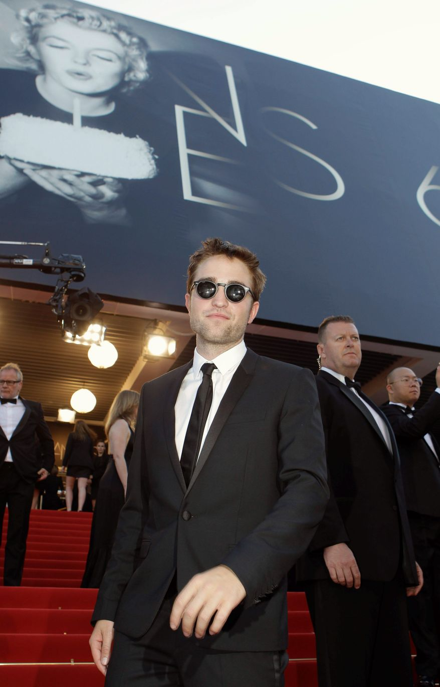 """""""People aren't thinking of me as a kid anymore, so I've got to stop behaving like one,"""" said Robert Pattinson, shown arriving for the screening of """"On the Road"""" on Wednesday at the Cannes Film Festival. (Associated Press)"""