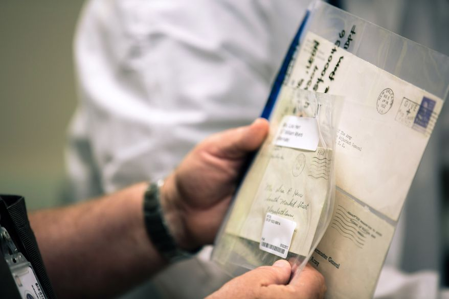 Letters from 1942 and 1953, which contain DNA, will be used to identify past military service members' remains at the Armed Forces DNA Identification Laboratory at Dover Air Force Base. The lab houses at least 6.7 million boxes of DNA specimen samples. (Andrew S. Geraci/The Washington Times)