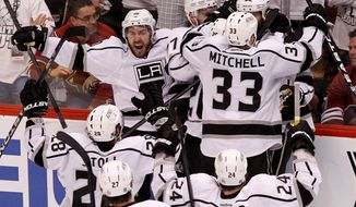 Kings players celebrate after Dustin Penner's goal 17:42 into overtime eliminated Phoenix and sent Los Angeles to its first Stanley Cup Final since 1993. The Kings will play either the New York Rangers or New Jersey Devils. (Associated Press)