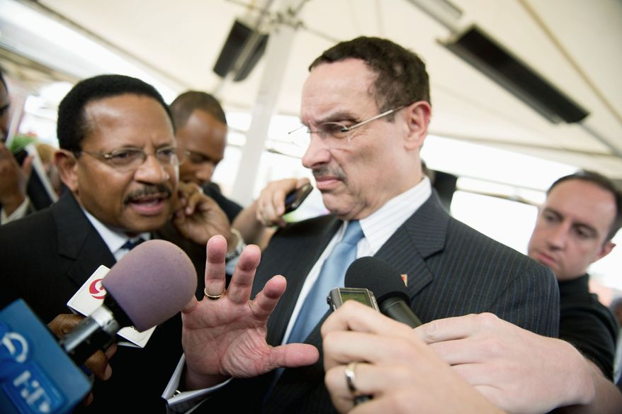 D.C. Mayor Vincent C. Gray faced reporters' questions about an aide's indictment after a news conference about street improvements. (Andrew Harnik/The Washington Times)