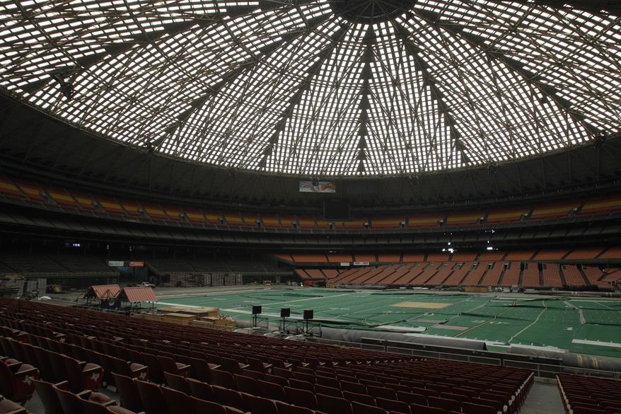 "Once touted as the ""Eighth Wonder of the World,"" the Astrodome gathers dust on Monday, May 21, 2012, in Houston. (AP Photo/Pat Sullivan)"