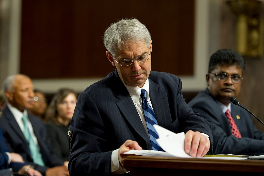 Mark Sullivan, left, director of the United States Secret Service, looks through notes while teatifying before the Committee on Homeland Security and Governmental Affairs at the Dirksen Building in Washington, D.C. on Wednesday, May 23, 2012, while Charles Edwards, acting inspector general of the U.S. Department of Homeland Security, looks on.  (Barbara L. Salisbury/The Washington Times)