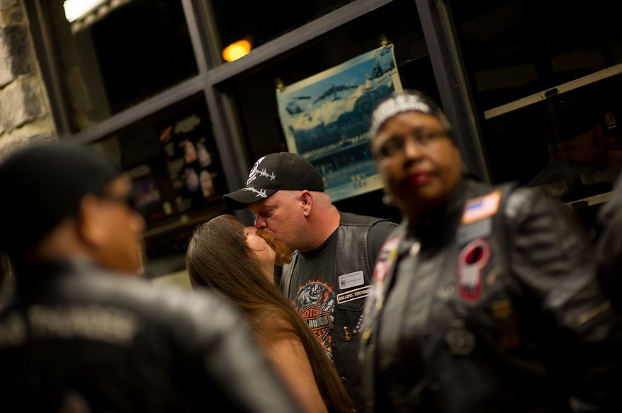 Jim Shekleton of Waldorf, Md. kisses his wife Britney as they and other  members of Rolling Thunder's Maryland chapter meet in the early morning hours at Harley Davidson's Ft. Washington store before heading to the Vietnam Memorial to help wash the memorial, Ft. Washington, Md., Sunday, May 13, 2012. (Andrew Harnik/The Washington Times)