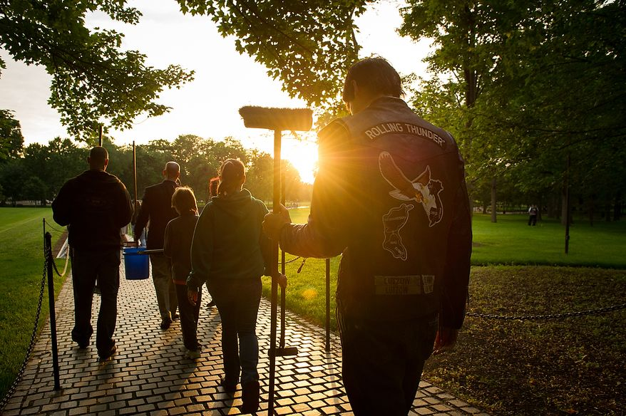 Brandon Lutzow, right, of Waldorf, Md., makes his way to the Vietnam Memorial with other members of Rolling Thunder's Maryland chapter in the early morning on the National Mall to help wash the memorial wall, Washington, D.C., Sunday, May 13, 2012. (Andrew Harnik/The Washington Times)