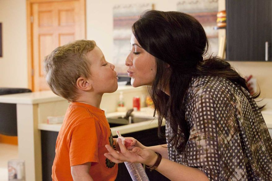 "Bristol Palin, daughter of former Alaska Gov. Sarah Palin, and her son, Tripp, film an episode of her new TV series, ""Bristol Palin: Life's a Tripp,"" premiering Tuesday, June 19, on Lifetime. (AP Photo/Lifetime, Richard Knapp)"