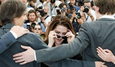 """Kristen Stewart, known for her work in """"Twilight,"""" is expanding into new territory with a role in an adaptation of Jack Kerouac's """"On the Road,"""" directed by Walter Salles (left). The film premiered at Cannes. (Associated Press)"""
