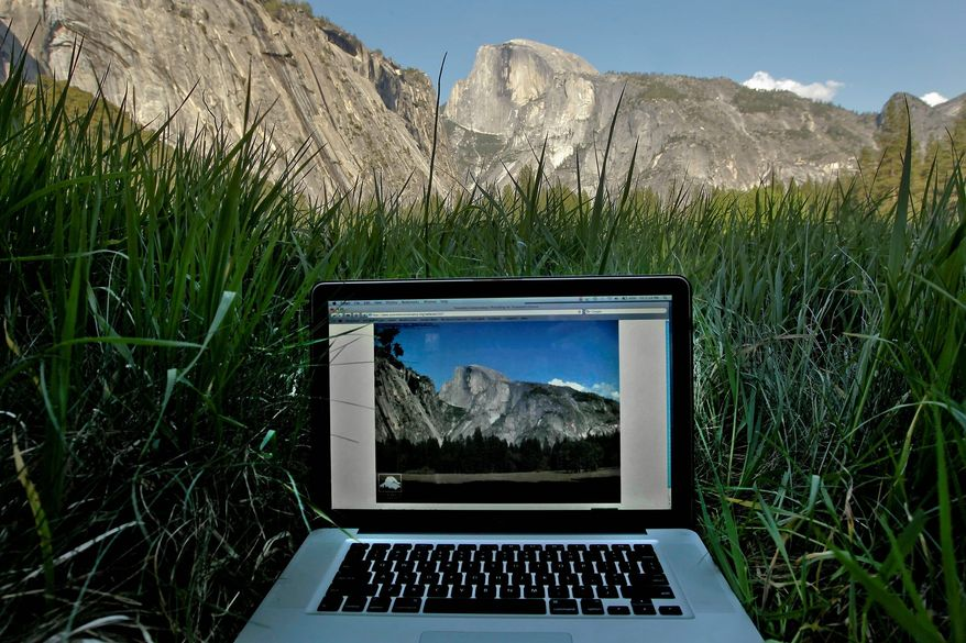 A live image of the Ahwahnee Meadow is displayed on a screen at Yosemite National Park in California. The Yosemite Conservancy has installed their latest webcam to give the public live online feeds of Yosemite Falls. They now have several webcam images online to also give visitors views of El Capitan, Half Dome and Sentinel Dome. (San Francisco Chronicle via Associated Press)