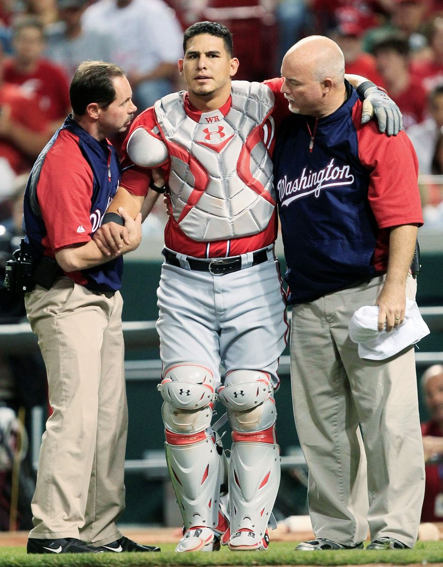 Wilson Ramos' season came to an abrupt end nearly two weeks ago when his cleat caught while he was making a play. The Nationals' medical director says recovery time ranges from six months to a year, though the schedule is different for everyone. (Associated Press)