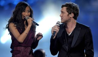 "Runner-up Jessica Sanchez, left, and ""American Idol"" winner Phillip Phillips perform onstage at the show's finale on Wednesday, May 23, 2012 in Los Angeles. (Photo by John Shearer/Invision/AP)"