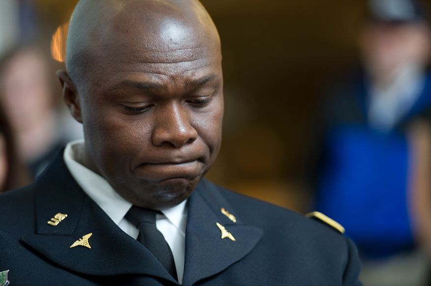 Olubenja Obasanjo, a major in the U.S. Army, has a quiet moment after becoming a U.S. citizen Thursday, May 24, 2012 at a naturalization ceremony at the Smithsonian Institute's National Museum of American History in Washington, D.C. (Barbara L. Salisbury/The Washington Times)