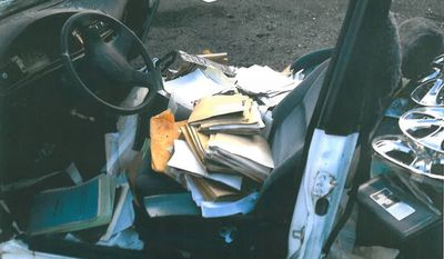 A photograph provided to the D.C. Office of the Inspector General by the heads of the fire and police unions shows personnel files found in an abandoned car at the D.C. fire training academy.