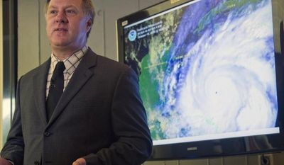 Gerry Bell, lead seasonal hurricane forecaster at the National Oceanic and Atmospheric Administration's Climate Prediction Center, discusses the upcoming hurricane season at a press conference in Miami on Thursday, May 24, 2012. (AP Photo/J. Pat Carter)