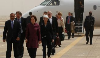 World powers negotiators arrive May 23, 2012, at the Baghdad International Airport in Iraq. Negotiators from the U.S. and five other world powers sat down with a team of Iranian diplomats to try to hammer out specific goals in the years-long impasse over Tehran's nuclear program. (Associated Press)