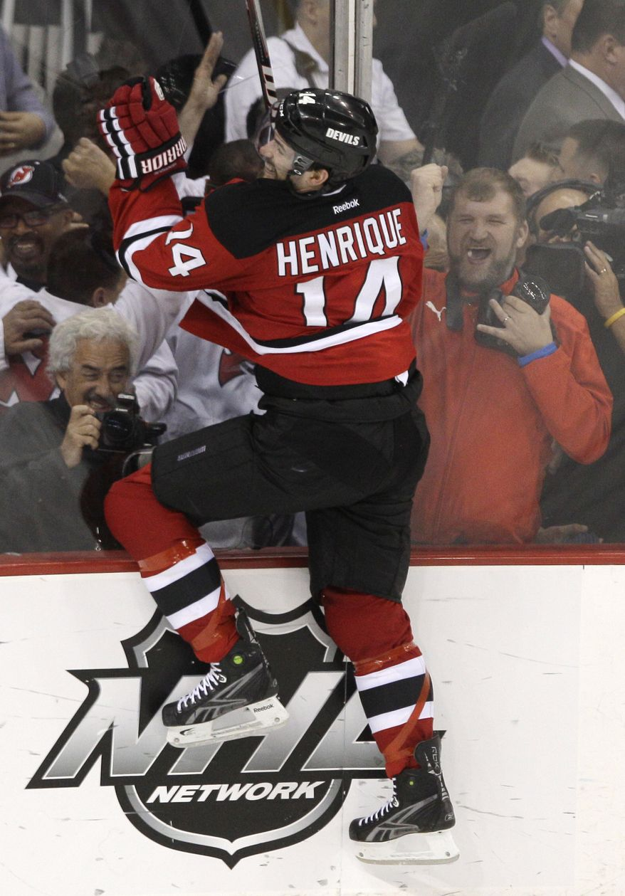 New Jersey Devils' Adam Henrique celebrates after scoring the game-winning goal in overtime against the New York Rangers to send his team to the Stanley Cup finals. (AP Photo/Frank Franklin II)