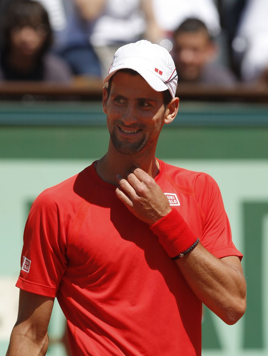 Novak Djokovic hasn't lost a Grand Slam match since falling in the 2011 semifinal at the French Open. He's looking for his fourth straight major tennis tournament win in this year's French Open. (AP Photo/Bertrand Combaldieu)