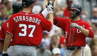 Washington Nationals' Danny Espinosa celebrates with Stephen Strasburg after hitting a three-run home run in the second inning against the Atlanta Braves on Saturday, May 26, 2012, in Atlanta. (AP Photo/John Bazemore)