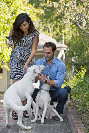 Karine and Aaron Hirschhorn started DogVacay, a website pet owners can use to find a sitter before going on vacation. (Associated Press)