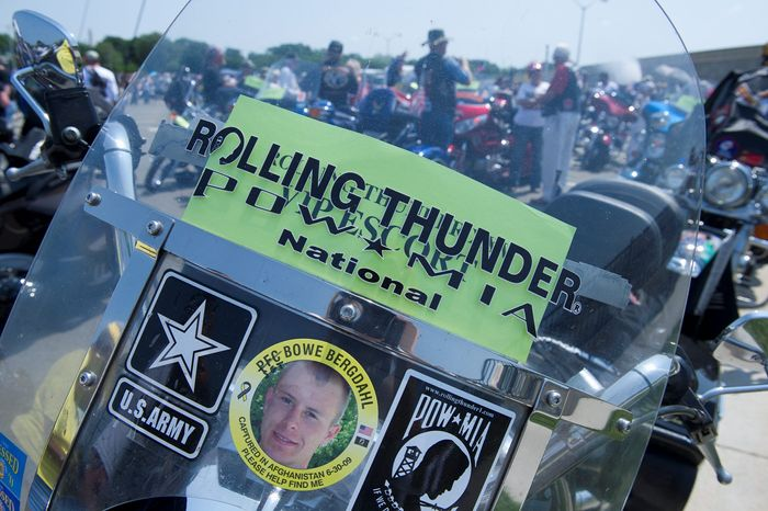 A motorcycle waiting at the Pentagon for the ride into the District features a picture of Sgt. Bowe Bergdahl, captured in Afghanistan in June 2009 and still being held by the Taliban. (Barbara L. Salisbury/The Washington Times)