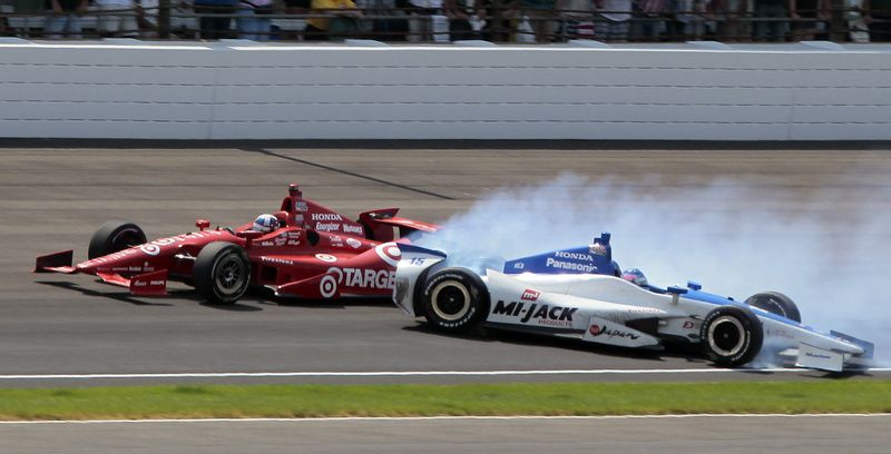 Takuma Sato, right, of Japan, spins in the first turn under Dario Franchitti, of Scotland, on the final lap of IndyCar's Indianapolis 500 auto race at Indianapolis Motor Speedway in Indianapolis, Sunday, May 27, 2012. (AP Photo/Bill Friel)
