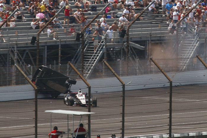 Will Power and Mike Conway crash during the Indianapolis 500 auto race at the Indianapolis Motor Speedway on Sunday, May 27, 2012. (AP Photo/LAT, Michael L. Levitt)