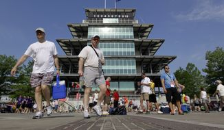 "Race fans cross the famous ""Yard of Bricks"" in front of the Pagoda on their way to their seats before the running of the 96th Indianapolis 500 auto race at the Indianapolis Motor Speedway in Indianapolis on Sunday, May 27, 2012. (AP Photo/Darron Cummings)"
