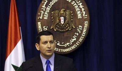 Syrian Foreign Ministry spokesman Jihad Makdissi denies during a news conference in Damascus, Syria, on Sunday, May 27, 2012, that government troops were behind an attack on a string of villages that left more than 90 people dead. (AP Photo/Bassem Tellawi)