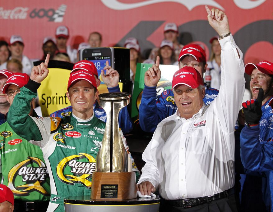 Kasey Kahne, left, and team owner Rick Hendrick pose with the trophy in victory lane after winning the NASCAR Coca-Cola 600 Sprint Cup Series auto race in Concord, N.C., Sunday, May 27, 2012. (AP Photo/Terry Renna)