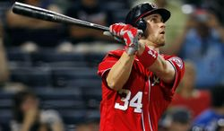 Washington Nationals' Bryce Harper (34) follows through with a solo home run in the eighth inning of a baseball game against the Atlanta Braves, Sunday, May 27, 2012, in Atlanta. (AP Photo/John Bazemore)