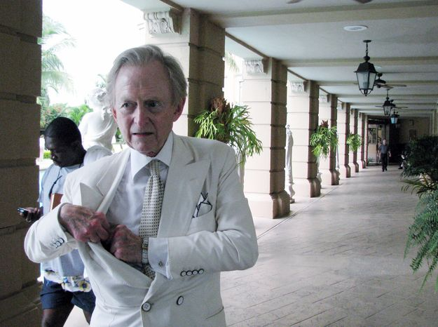 In this Oct. 13, 2008 photo provided by Oscar Corral, writer Tom Wolfe is shown in Miami, Fla. For decades master journalist turned novelist, Tom Wolfe has quietly moved through the U.S., soaking up the lives of the rich and poor for his outrageous, yet spot-on tales of American excess. Wolfe's latest work, a much anticipated novel set in Miami, will be released in October. Wolfe a