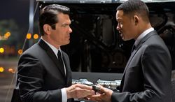 """In this film image released by Sony Pictures, Josh Brolin, left, and Will Smith star are shown in a scene from """"Men in Black 3."""" (AP Photo/Columbia Pictures-Sony, Wilson Webb)"""